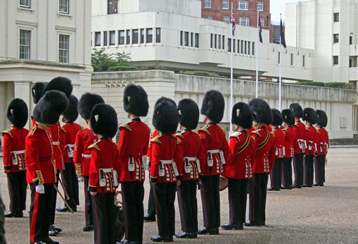 Grenadier guards at attention while inspection by officers