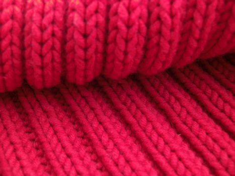 detail of a red cardigan