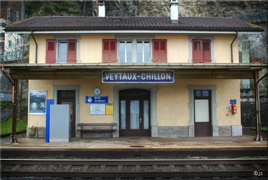 Frontal view of Veytaux-Chillon Train Station outside of Lausanne Switzerland showing railroad track.