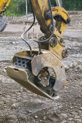A heavy duty tamper at a construction site.