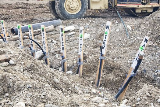 Pipes for water service are ready for hooking up at a construction site.