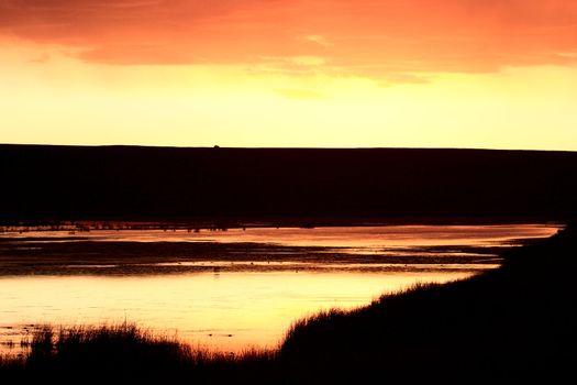 Sun set behind hills of Eyebrow Lake
