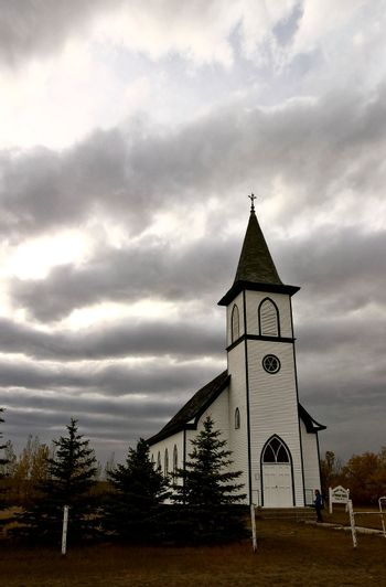 Cloudy skies over a country church