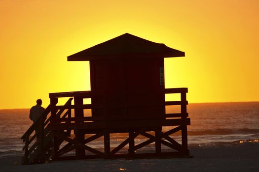 Sun setting behind Life Guard hut on Gulf Coast of Florida