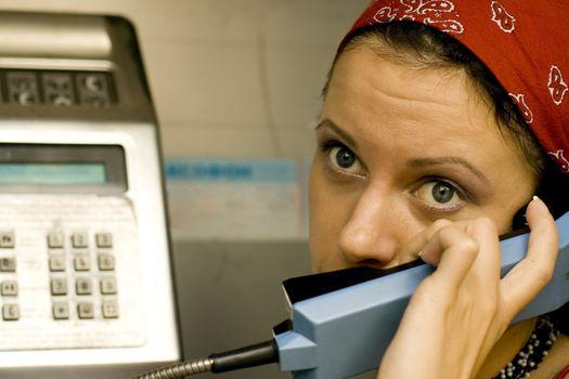 girl having a call on a telephone