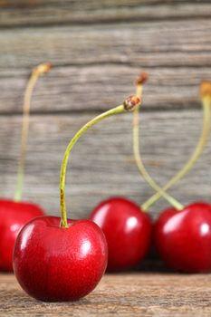 Red cherries on barn wood