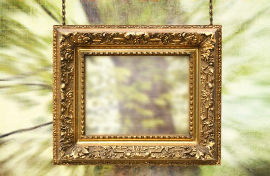 Gilded frame hanging with spring abstract background