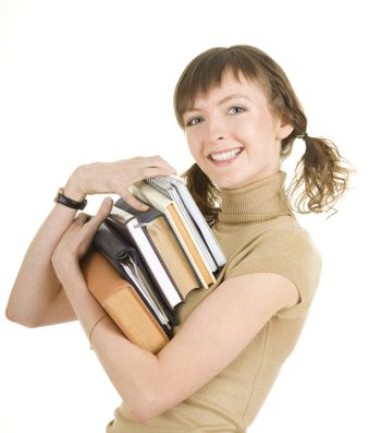 girl with a pile of books on white background