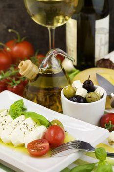 italian tomato mozarella, olives, wine and cheese