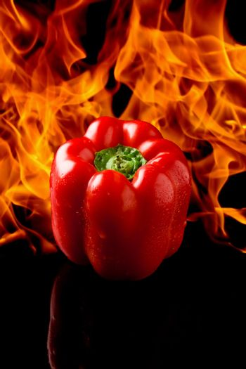 Pepper with fire background