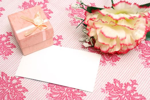 A jewelry box on top of a blank notecard.