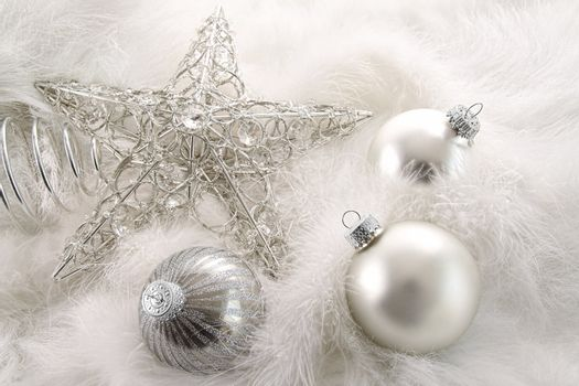 Silver holiday ornaments in feathers