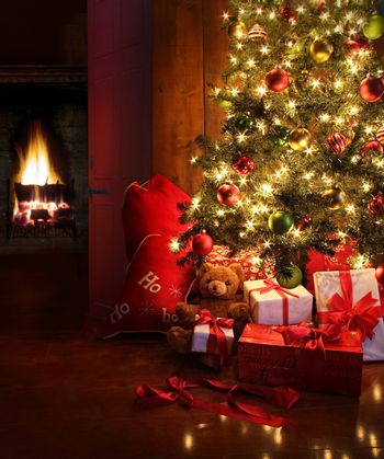 Christmas scene with tree and fire in background
