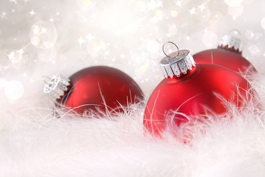 Red Christmas balls in white feathers