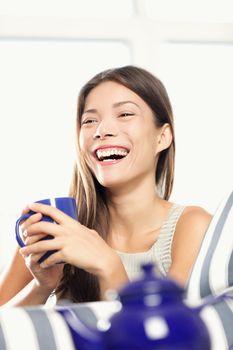 Woman laughing drinking tea