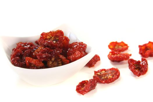 fresh dried tomatoes on a white background