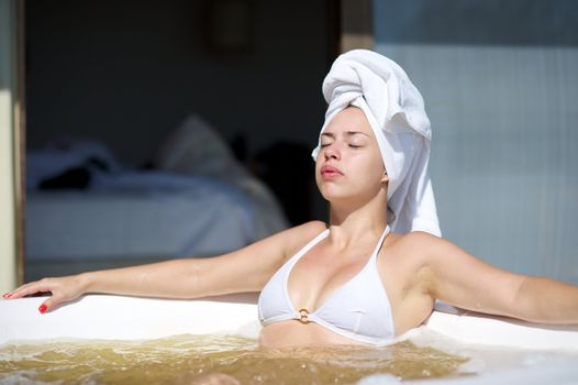 Woman relaxing in a jacuzzi in a resort in Porto Belo, Santa Catarina, Brazil