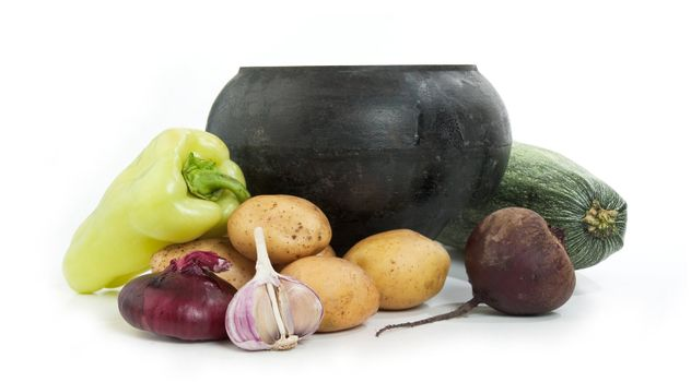 cast iron pot and vegetables