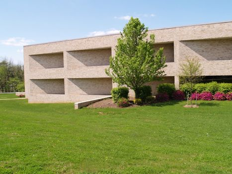 exterior of a modern brick building with a grass lawn in front