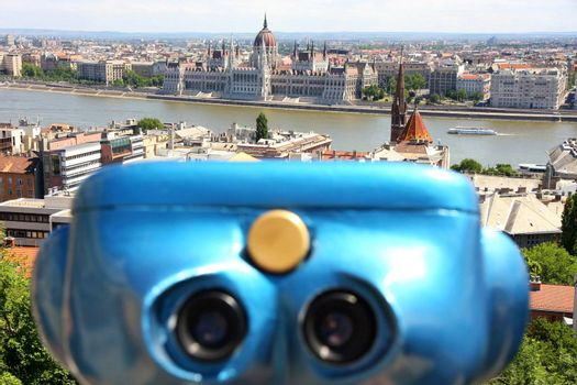 The parliament building with binoculars in Budapest, Hungary