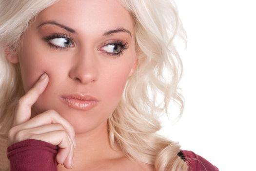 Beautiful young blond woman thinking