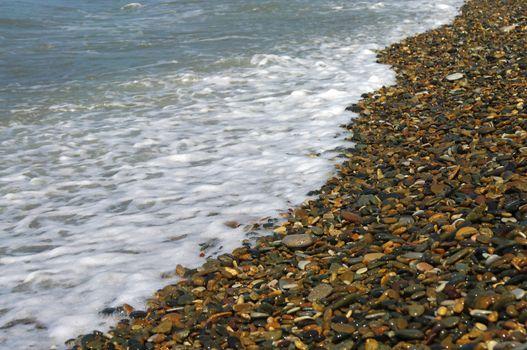 Sea-wave and shingle