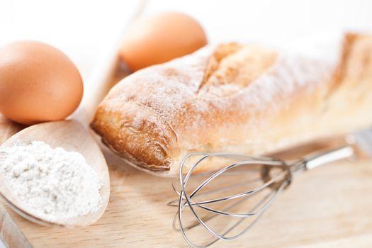 bread, flour, eggs and kitchen utensil