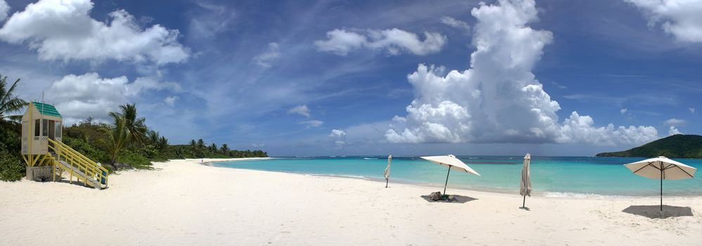 A wide angle panoramic view of the amazing clear blue Caribbean water and white sands of Flamenco beach on the Puerto Rican island of Culebra.