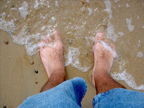The ocean is washing ashore on my piggie toes.