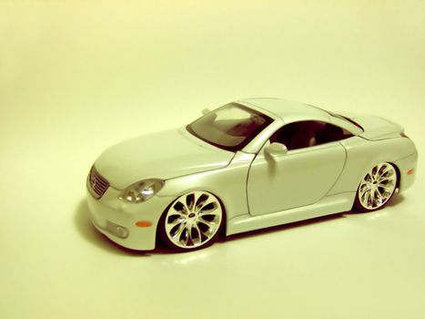 Yellow filter over a shot of this Lexus diecast.