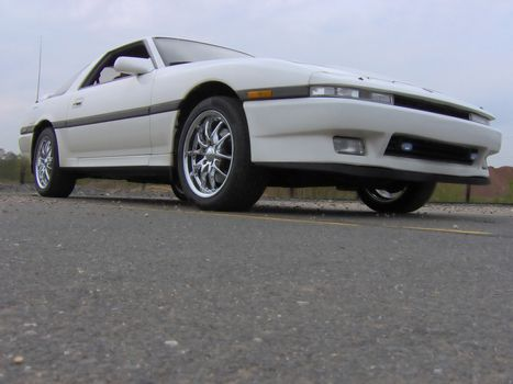 Doesn't look 20 years old, does it? A low shot of a white sports car