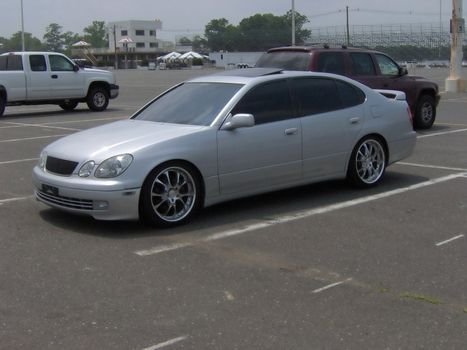 this is a lexus gs with rims and tints.