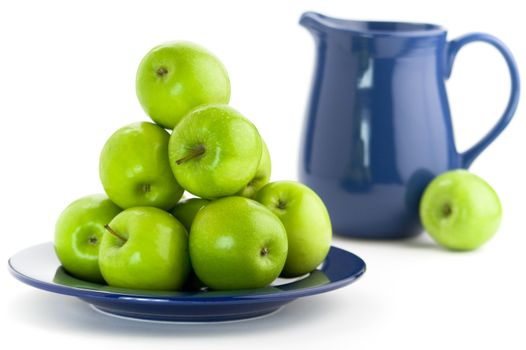 Green apples and blue pitcher