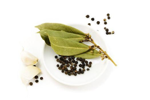 garlic, peppercorn and bay leaf