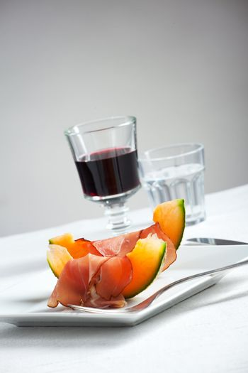 ham and melon slices on a plate