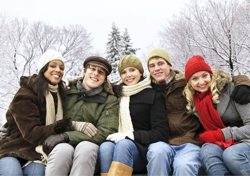 Group of diverse young friends outdoors in winter