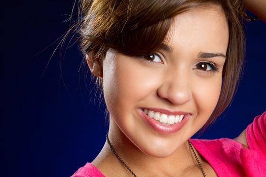 Pretty smiling young hispanic girl