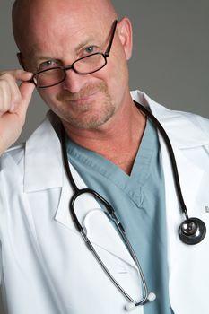 Handsome smiling doctor wearing glasses