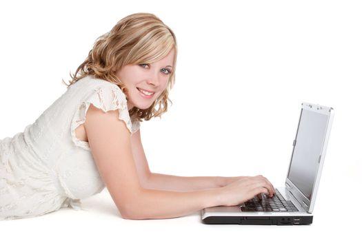 Smiling blond woman using laptop