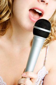 Beautiful closeup singing microphone girl