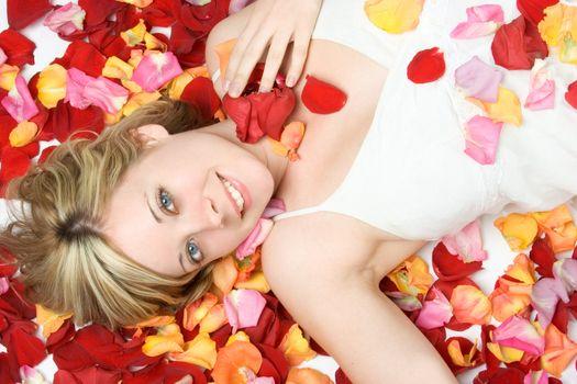 Smiling beautiful flower petals woman