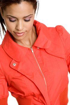 Black woman wearing orange jacket