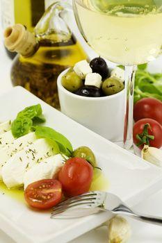 italian tomato mozarella, olives and wine
