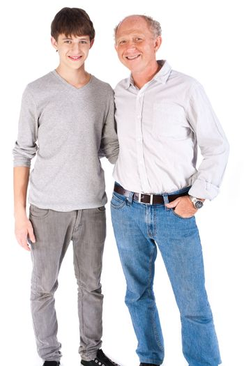 Teenager and grandfather isolated on white background.