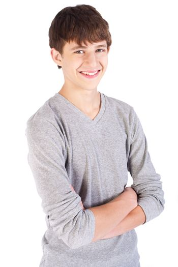 Handsome caucasian teenager posing with crossed arms..