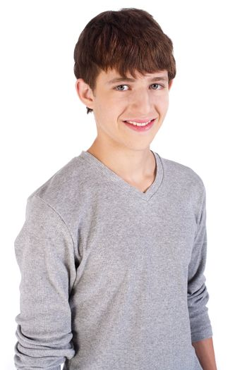 Adorable handsome young boy posing and smiling at camera.