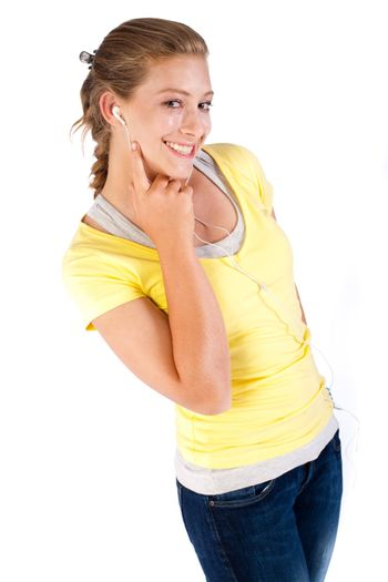 Girl with headphones isolated over white background..