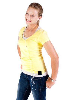 Young caucasian girl enjoying music and smiling at camera..