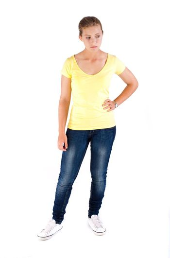 Beautiful young girl in stylish jeans isolated on white background.