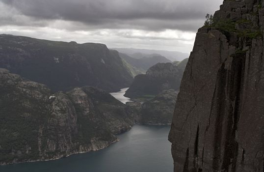 Almost colorless gloomy fjord landscape - mountains cliffs and water